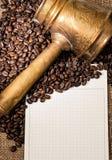 Blank notebook, copper turks, coffe grains Stock Image