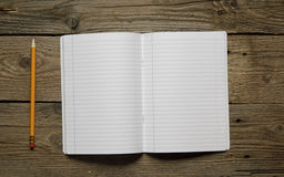 Blank notebook and different school objects Royalty Free Stock Images