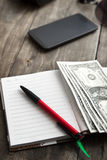 Blank notebook with dollar and smarthphone Royalty Free Stock Photography
