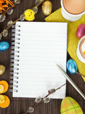 Blank notebook and Easter decorations. Copy space stock image