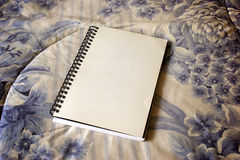 Blank notebook on fabric Stock Photography