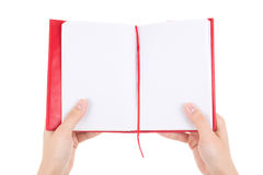Blank notebook in female hands isolated on white Stock Photography
