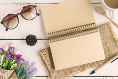 Blank notebook with flower and cup of coffee Royalty Free Stock Images