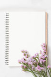 Blank notebook and flower Stock Image