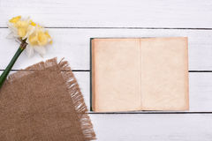 Blank notebook with flower on vintage wooden table background top view Royalty Free Stock Photos