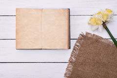 Blank notebook with flower on vintage wooden table background top view Stock Photos