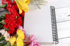 Blank notebook with flower on vintage wooden table Valantines Day Royalty Free Stock Images