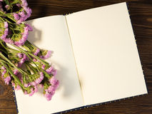 Blank notebook with flower Stock Photos