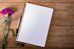 Blank Notebook with Flower on Wooden Table Stock Photos