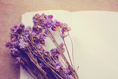 Blank notebook and flowers with retro filter effec Royalty Free Stock Photo