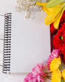 Blank notebook and flowers wood background Valantines Day. Blank notebook Concept and Decoration royalty free stock photography