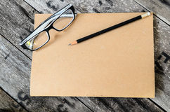 Blank notebook, glasses Royalty Free Stock Images
