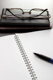 Blank notebook and glasses Royalty Free Stock Photos
