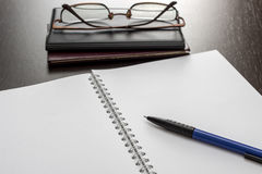 Blank notebook and glasses Stock Photography