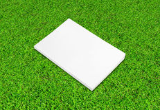 Blank notebook on Green Grass Royalty Free Stock Images