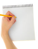 Blank notebook. Hand drawing gesture with pencil and pad isolated Stock Photography
