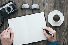 Blank notebook on a hipster desktop stock photos