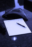 Blank notebook with intercom for conference call Royalty Free Stock Photography