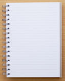 Blank notebook line. White wood Stock Photography