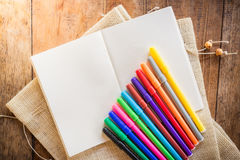 Blank notebook with many color markers Royalty Free Stock Photos