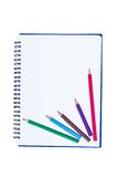 Blank notebook with metal spiral and two crayons Stock Photo