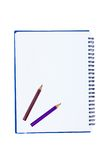 Blank notebook with metal spiral and two crayons Royalty Free Stock Photography