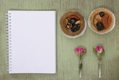Blank notebook mock up for artwork with pink roses and cake. Place for text. Fresh flower. Stock Photography