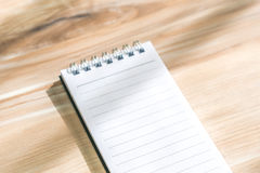 Blank notebook mock up on wood background Royalty Free Stock Images