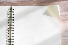 Blank notebook mock up on wood background Royalty Free Stock Photo