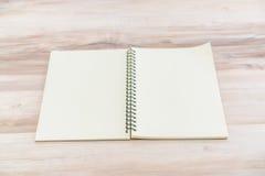 Blank notebook mock up on wood background Stock Image