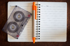 blank notebook with music and cassette Stock Photography