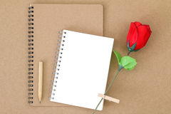 Blank notebook on natural brown paper next to wooden pencil and Royalty Free Stock Images