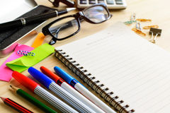 Blank notebook with office supply on desk Royalty Free Stock Images