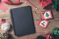 Blank notebook on old wooden background with decorations Royalty Free Stock Images