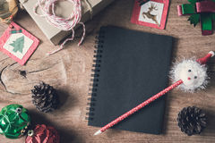 Blank notebook on old wooden background with decorations Stock Photo
