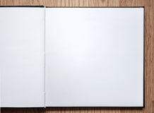Blank notebook opened on wood background Stock Photography