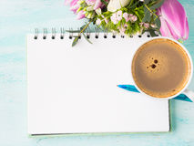 Blank notebook page with blue pen and cup coffee flowers. Blank empty notebook page with blue pen and cup of coffee. Spring summer flat lay with flowers Royalty Free Stock Photos