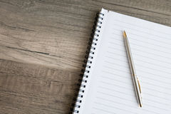 A blank notebook. With a pen Royalty Free Stock Image