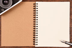 Blank notebook and pen with camera Stock Images