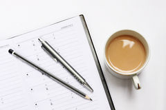 Blank notebook with pen and coffee cup. On white Royalty Free Stock Photography