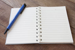 Blank notebook and pen color on wooden floor. Royalty Free Stock Photography
