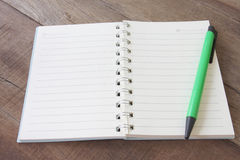 Blank notebook and pen color on wooden floor. Stock Images