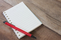 Blank notebook and pen color on wooden floor. Royalty Free Stock Images