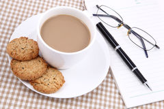Blank Notebook, Pen and cup of coffee. At workplace Royalty Free Stock Photo