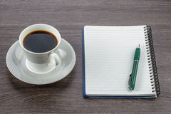 Blank notebook and pen with cup of coffee Stock Image
