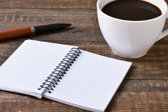Blank notebook, pen and cup of coffee Royalty Free Stock Image