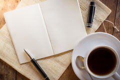 Blank notebook with pen and cup of coffee Royalty Free Stock Photography