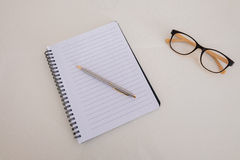 A blank notebook. With a pen and glasses Royalty Free Stock Images