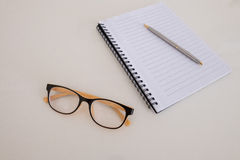 Blank notebook. A blank notebook with a pen and glasses Royalty Free Stock Images