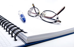 Blank notebook with pen and glasses Royalty Free Stock Photos